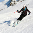 Woman is skiing at a ski resort — Stock Photo