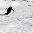 Stock Photo: Woman is skiing at a ski resort