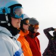 A woman photographs a group of skiers — Stock Photo