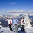 Stock Photo: Skiers mountains in the background
