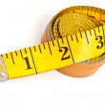 Yellow tailor's meter — Stock Photo