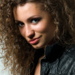 Beautiful young woman with curly hair — Stock Photo