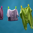 Children's clothing hanging on a rope — Stock Photo