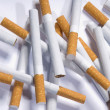 Cigarettes lying on a white background - Stockfoto