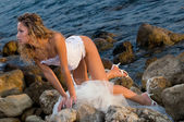 Bride and the sea — Stock Photo