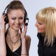 Two women listening to music — Stock Photo #3540295