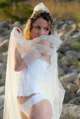 Young bride on the beath — Stock Photo