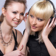Two women listening to music — Stock Photo #3587348