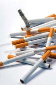 Cigarettes on a white background — Stock Photo
