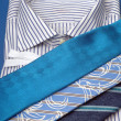 Ties of different colors lie on a shirt — Stock Photo