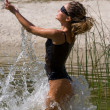 Young woman splashing in the water - Foto de Stock  