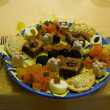 Dish of candies and dried fruits — Stockfoto