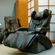 Black massage chair - Stok fotoraf