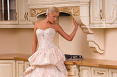 Bride in the kitchen — Stock Photo
