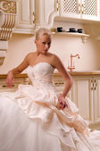 Young bride in the kitchen — Stock Photo