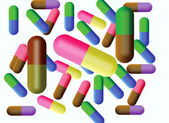Gekleurde tabletten in capsule — Stockfoto