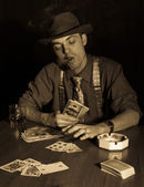 Old style gambler with money and cigar — Stock Photo