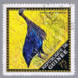 Royalty-Free Stock Photo: Bird on postage stamp of Guinea