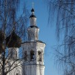 Royalty-Free Stock Photo: Church bell tower between birch trees
