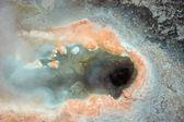 Geyser hole with orange sediments — Stock Photo