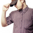 Working man locked cap - Stock Photo