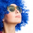 Happy woman in blue wig - Stock Photo