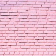 Pink brick wall texture on street - Stock Photo