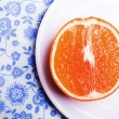 Grapefruit on plate on napkin - Stock Photo