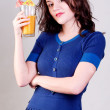 Beauty young woman with orange cocktail — Stock Photo