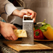 Grate Parmesan grated - Stock Photo