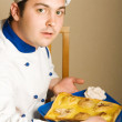 Handsome young chef in the living room w — Stock Photo #3022764