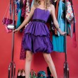 Beautiful woman in fashio clothes in the dressing room — Stock Photo