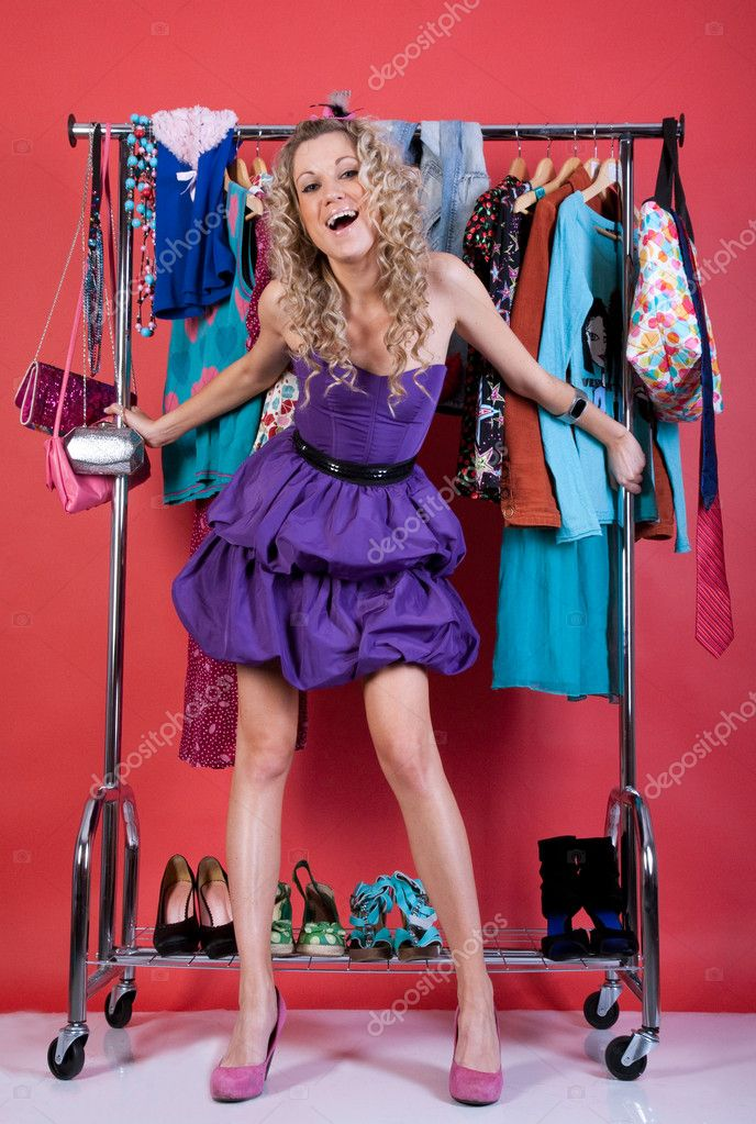 Beautiful girl in fashio clothes in the dressing room on a red background — Stock Photo #3284109