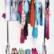 Clothing and shoes on the rack — Stock Photo