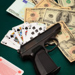 Cards, money and gun — Stock Photo