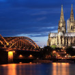 Cologne Cathedral and Hohencollernbridge - Stock Photo