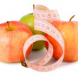 Pink measuring tape and three apples — Stock Photo