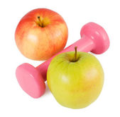Pink dumbbells and apples — Stock Photo