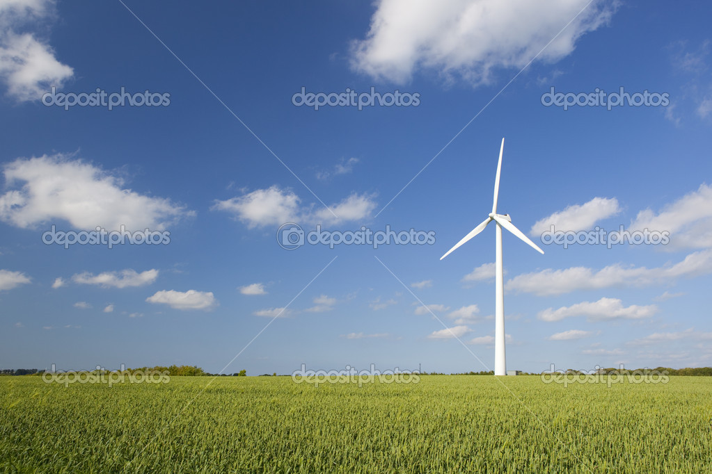 Windmill in green field — Stock Photo #3644595
