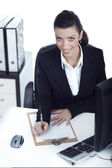 Business woman making notes — Stock Photo