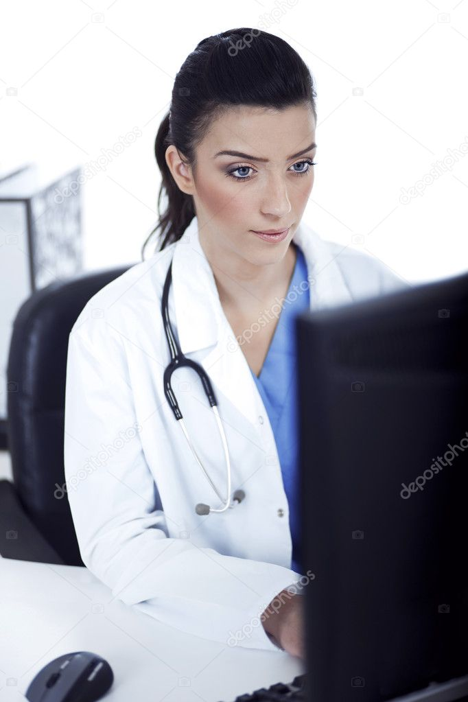 Young doctor working in the computer at her room — Stock Photo #2807070