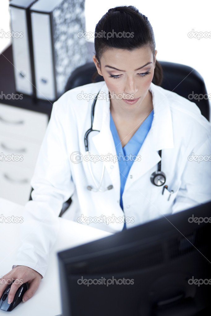 Top angle of the young doctor at her room over white background — Stock Photo #2807110