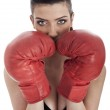 Woman covering her mouth with red gloves — Stock Photo #2826678