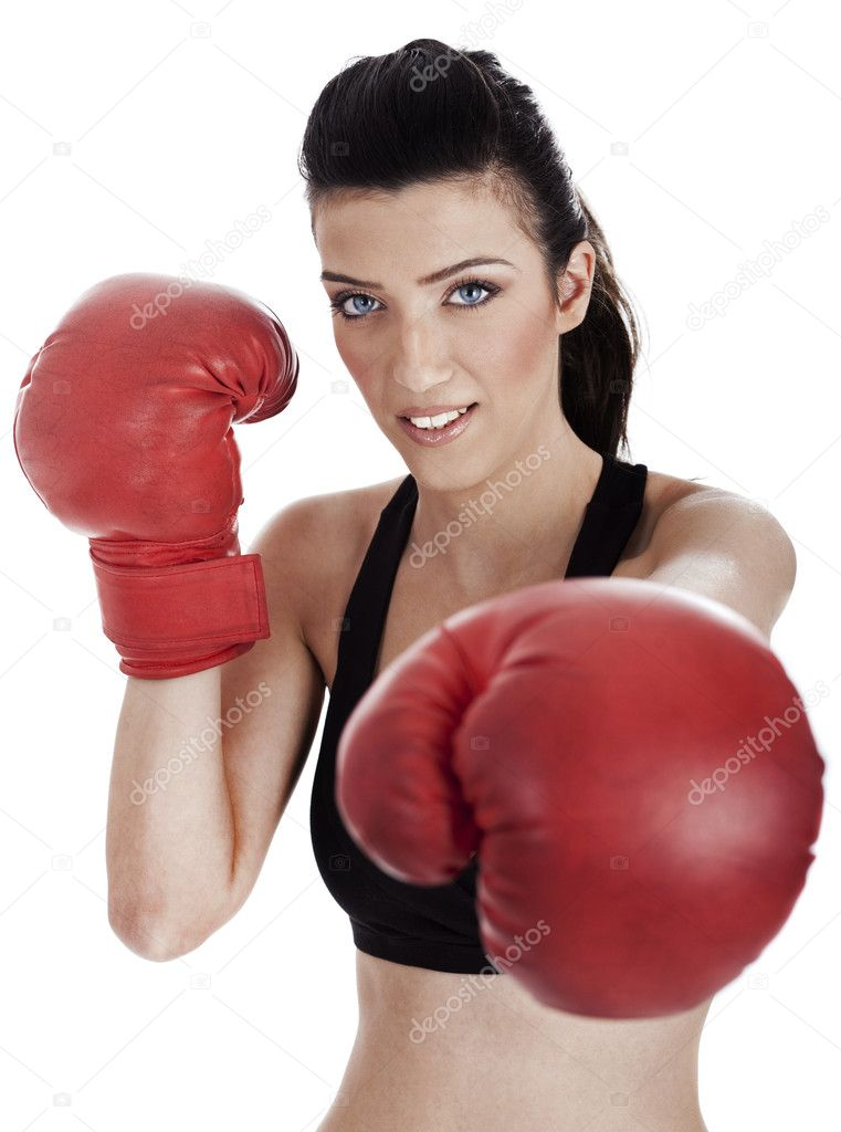 Woman boxer giving a punch over white background — Stock Photo #2826709