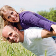 Happy couple enjoying with their arms — Stock Photo
