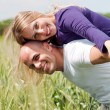 Man giving his wife a piggyback ride — Stock Photo