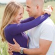 Men and woman hugging — Stock Photo