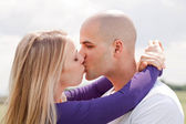 Beautiful picture of kissing couple — Stock Photo
