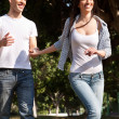 Young couple running in the park — Stock Photo #2998591