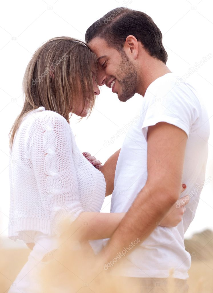 Portrait of lovely lovers hugging in the park  Stock Photo #3011973